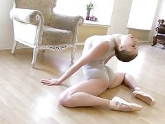 Gymnastic young shorthaired babe shows abilities