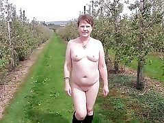 Saucy MILF's Nude Walk Through an Apple Orchard