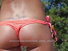Hot slender Ukraine babe. Beach voyeur