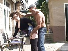 Kinky chick seizes his dick outdoors and then starts blowing it