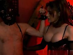 Sexy stunner wearing a slutty corset and sexually manhandling her victim