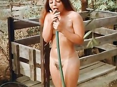 2 cowboys are spying on this naked babe taking shower outdoors