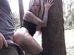 Long haired blonde having intercourse with her boyfriend in the woods